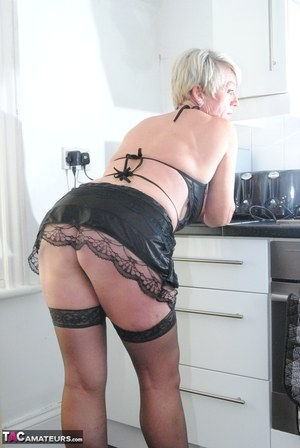 Sexy MILF In Kitchen